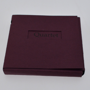 The front of the box that contains the set of books for Quartet