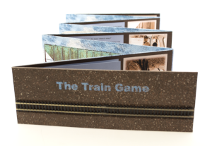 The Train Game partially unfolded with cover facing the camera