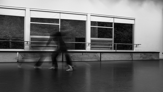 photo of dancers in movement in a dance studio
