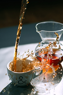Photo: Pouring too much tea into a cup.