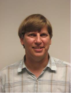 Librarian Paul Kauppila smiling