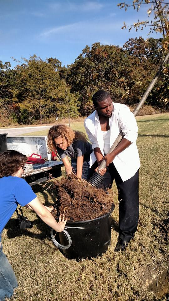 Picture of students at West Campus helping with planting new trees