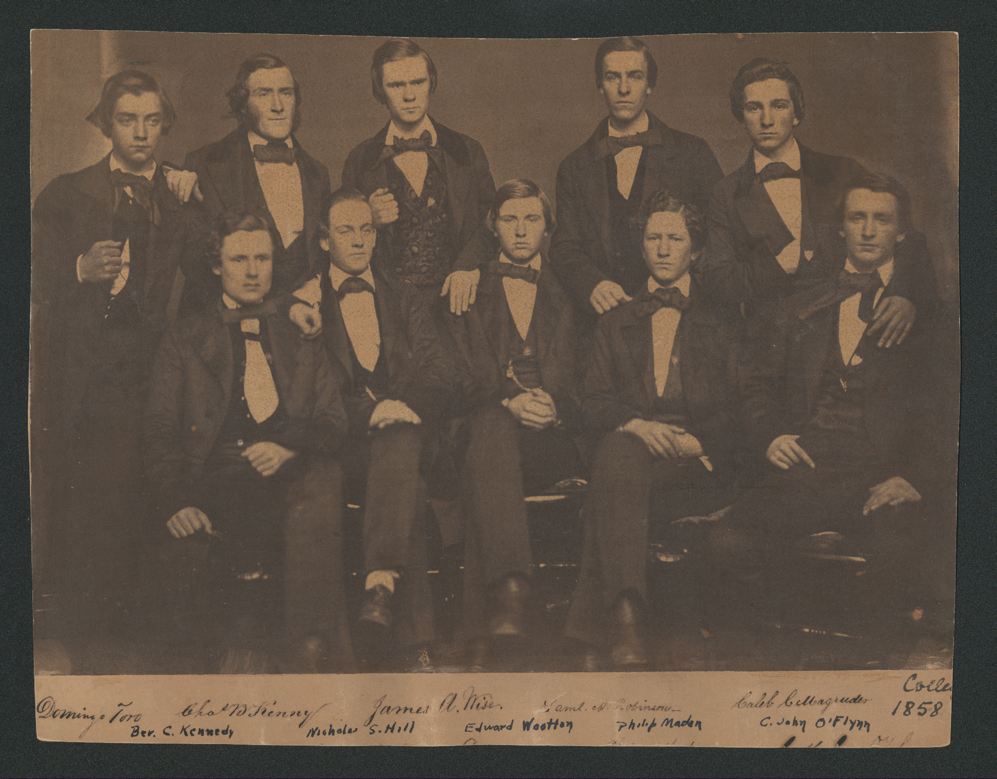 Sepia toned image of graduates wearing suits