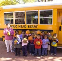 image of Head Start children, teacher, and school bus