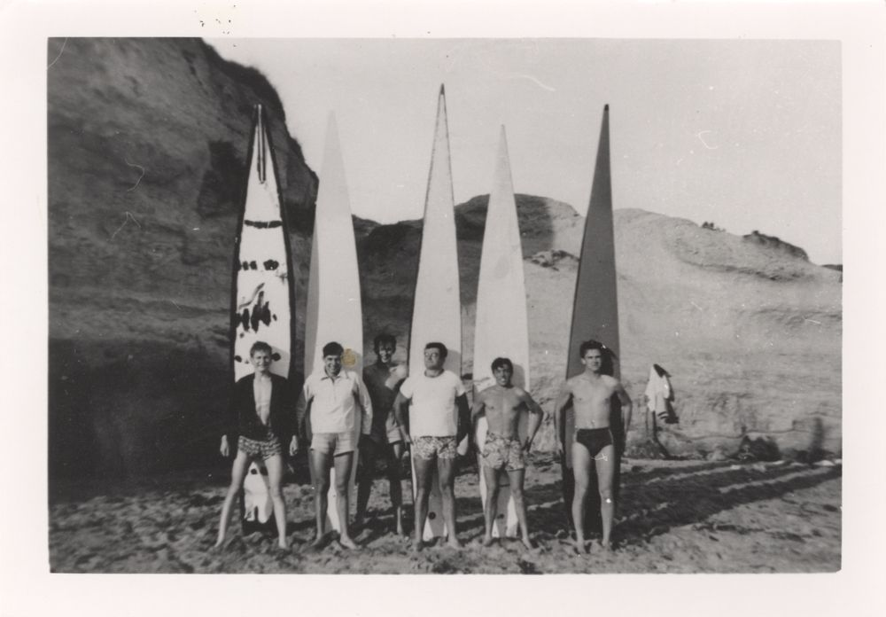 Photo of men with surfboards