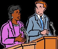 debaters standing at their podiums with microphones