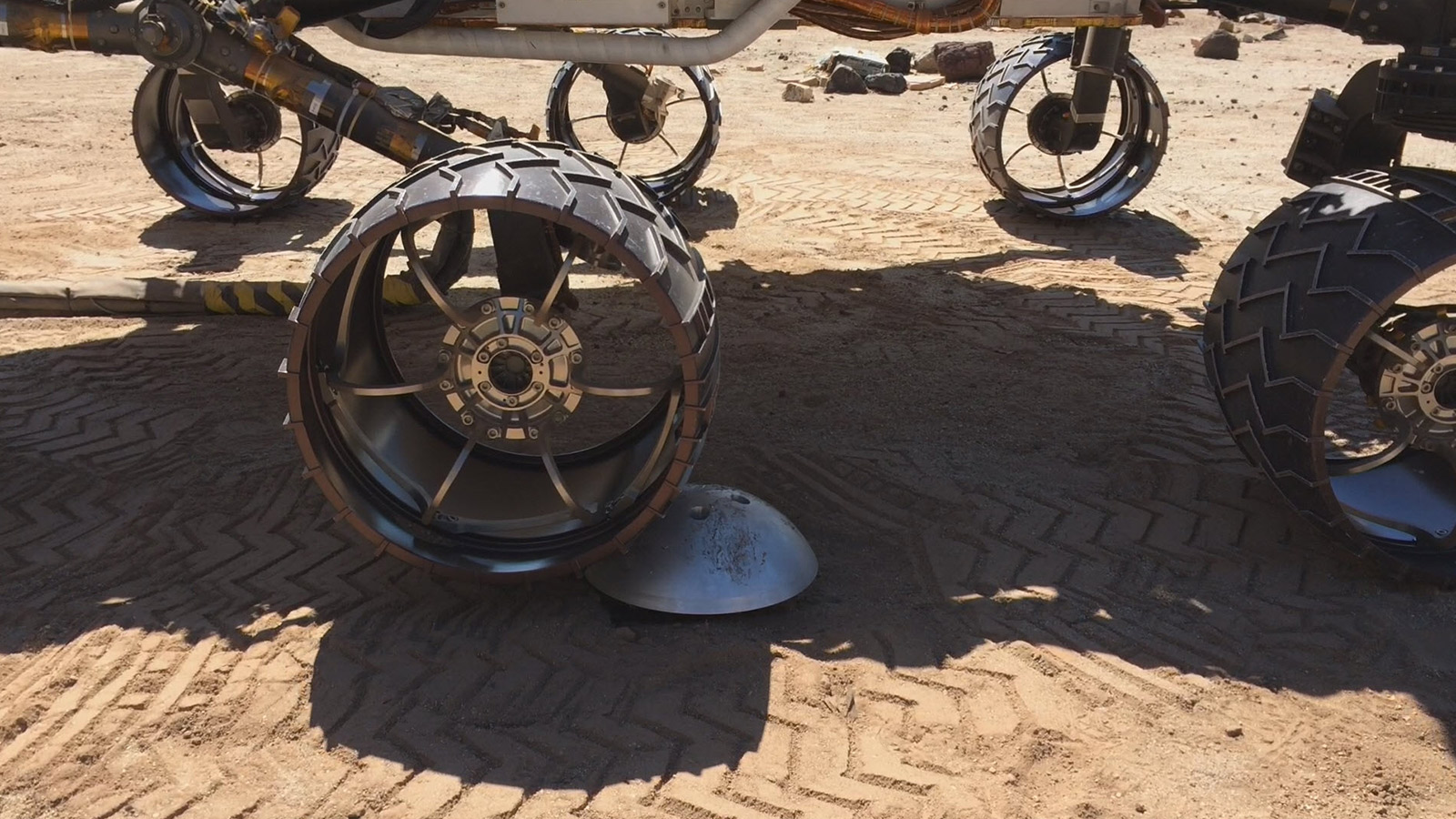 close up of robot wheels attempting to gain traction to roll over a smooth obstacle