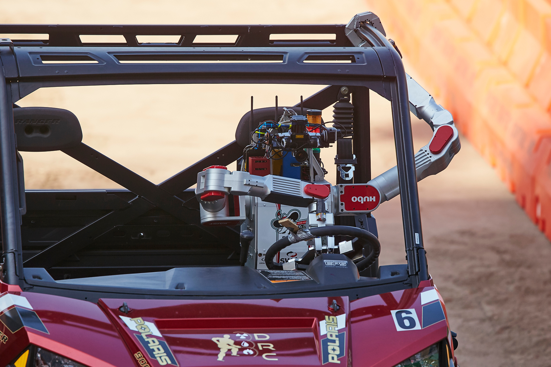 UNLV DRC-Hubo humanoid robot seated in vehicle