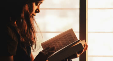 Photo of a woman reading a book