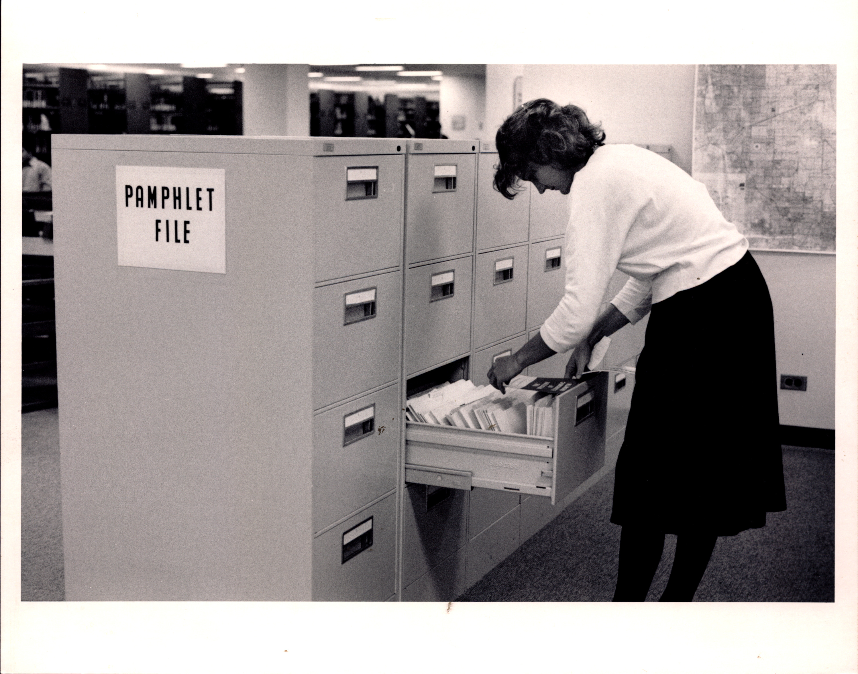 Female student using pamphlet file.