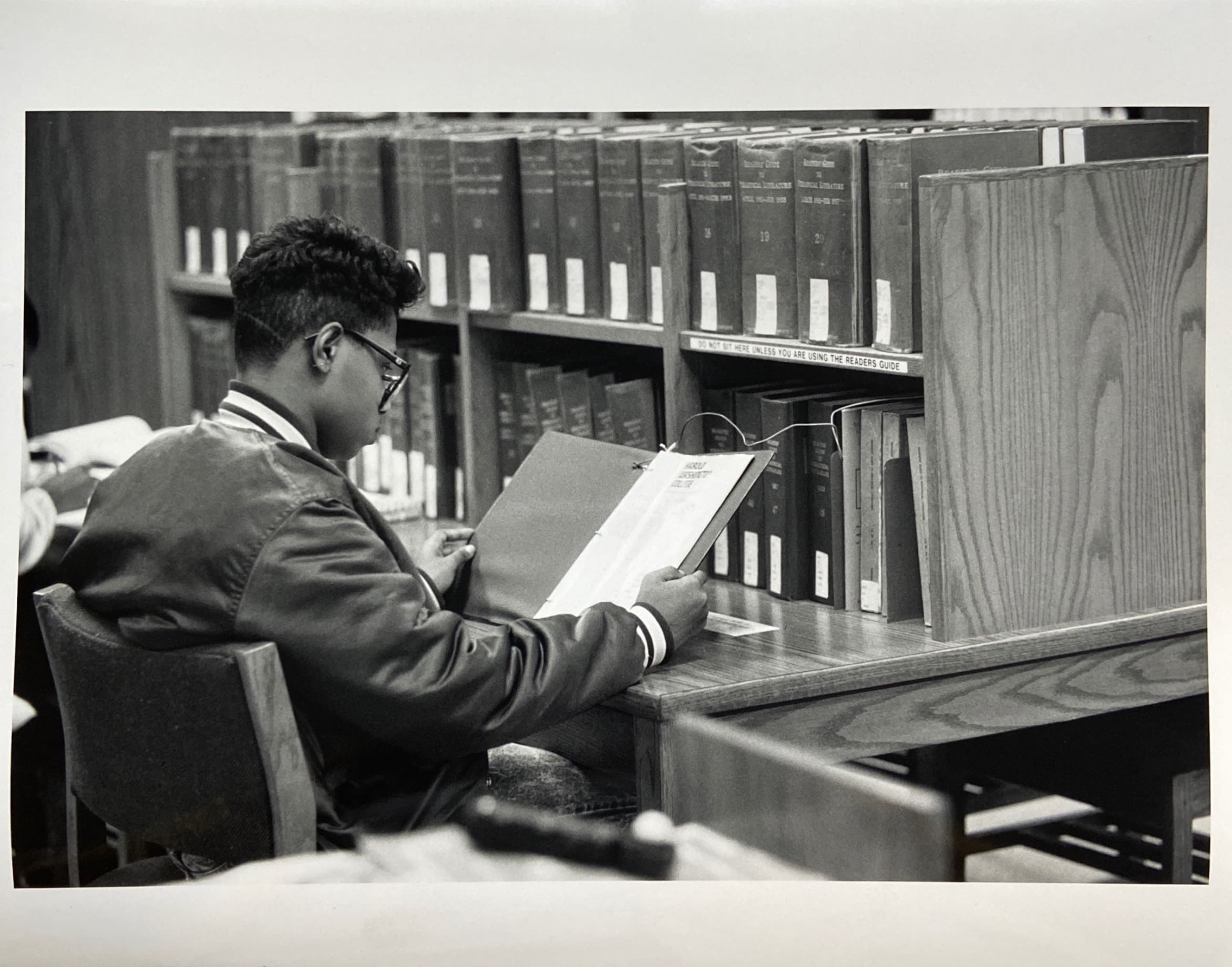 Photo of student reading in the library.