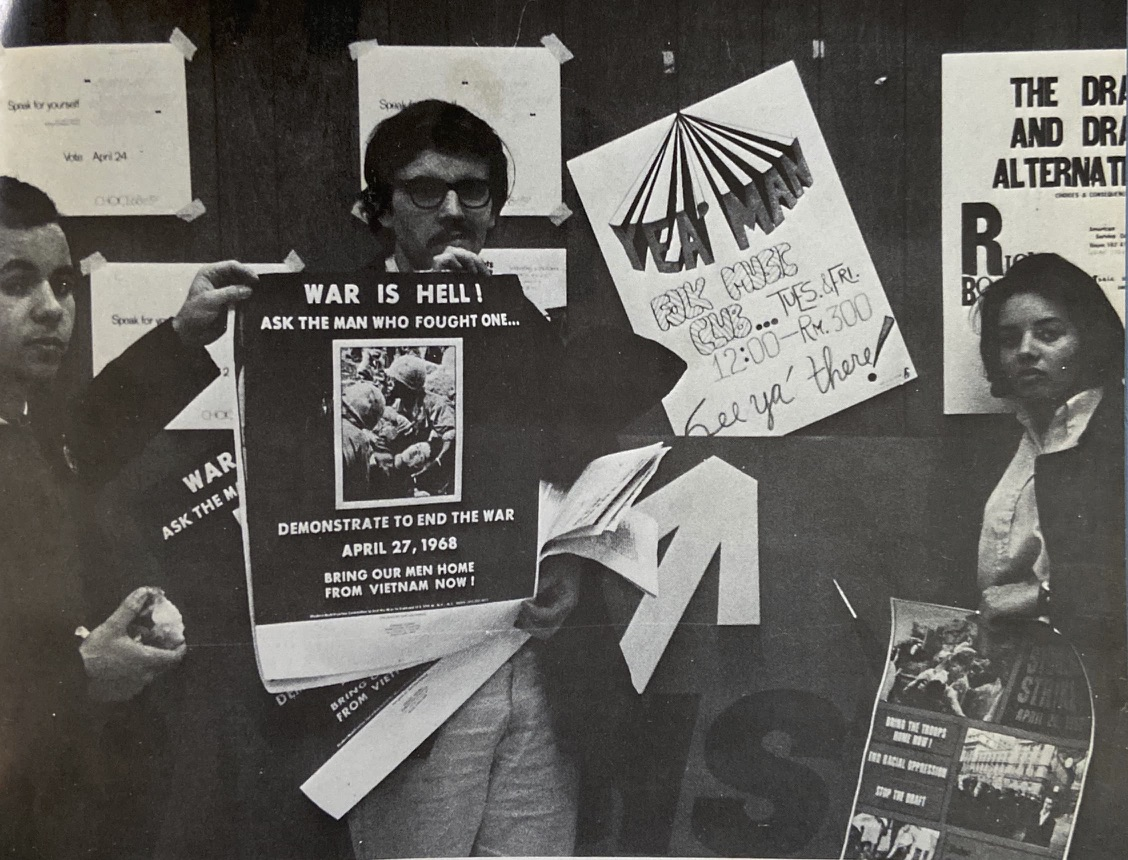 Photo graph of three students holding Vietnams War protest signs from the 1968 Loop College Yearbook.