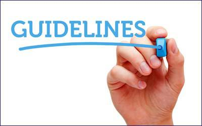 A hand writing the word guidelines on a transparent board