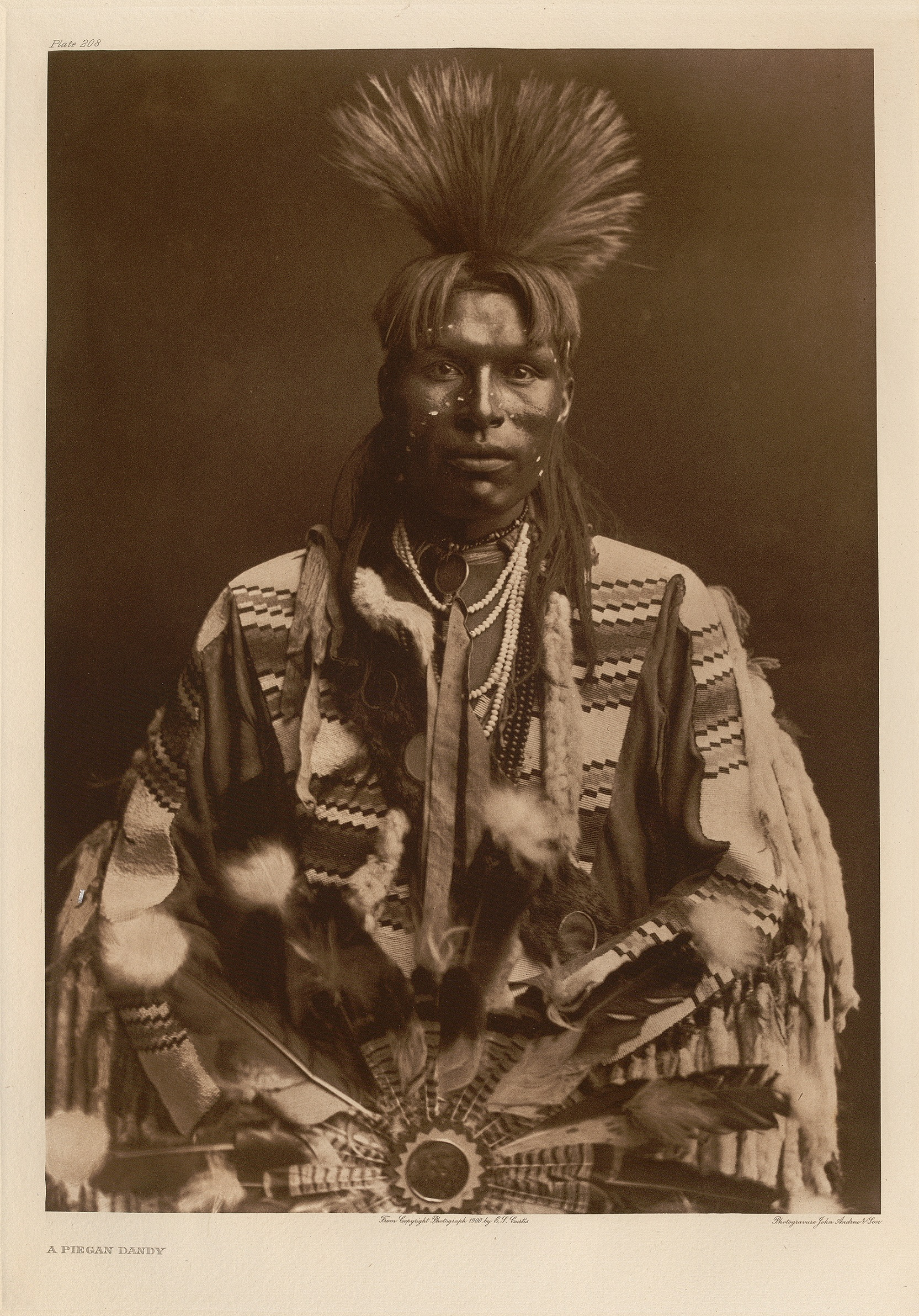 Photogravure of Piegan man in ceremonial dress