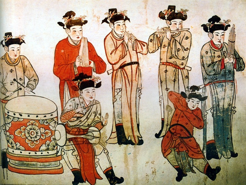Mural depicting a group of musicians and a woman dancing