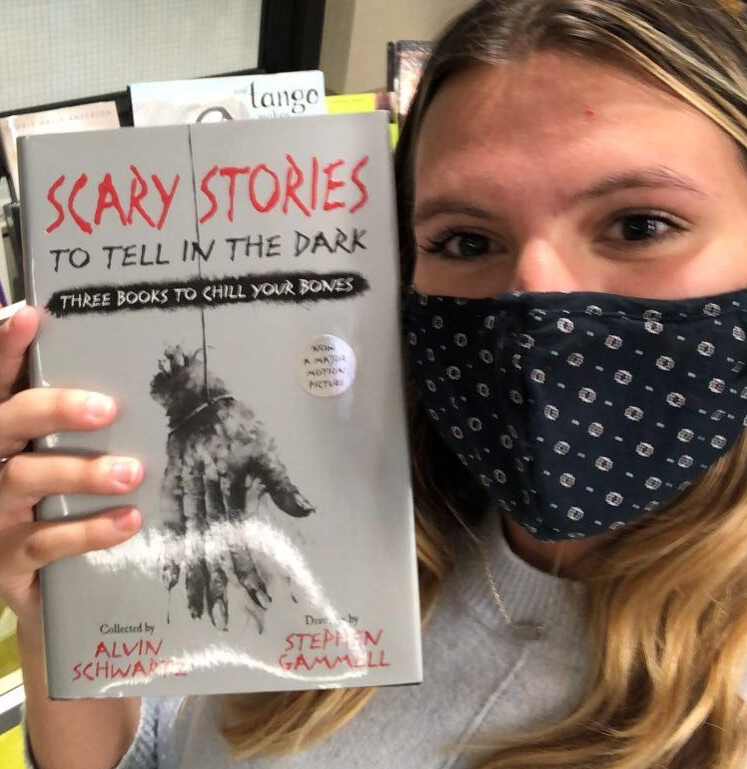 Jessica Duca with a book