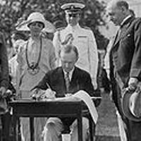 Coolidge signing Johnson Reed Act