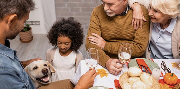 family with dog at table