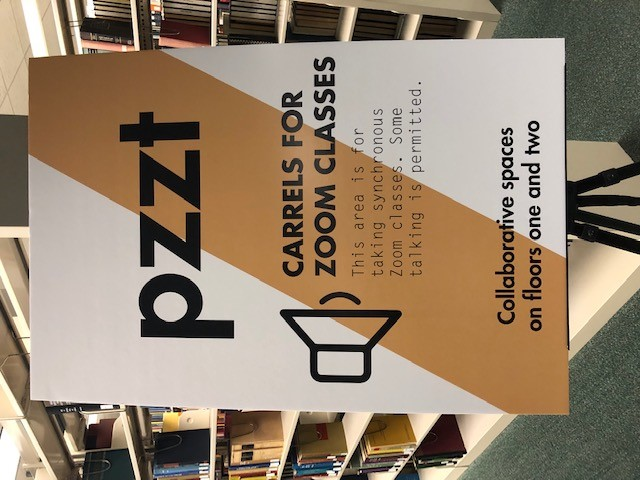 A sign marking carrels for Zoom classes