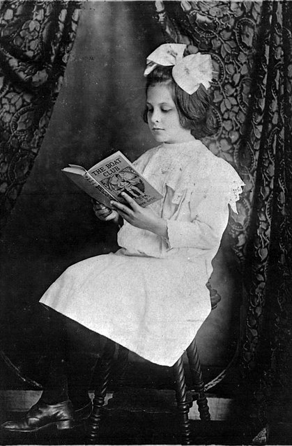 Photo of white girl with book, early 20th C.