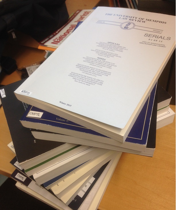 photo of stack of law journals