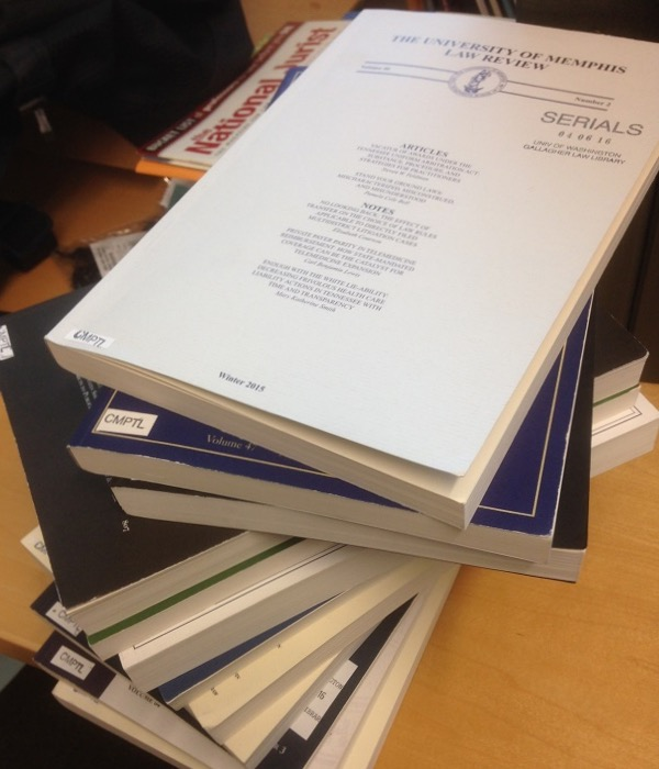 photo of a stack of journals