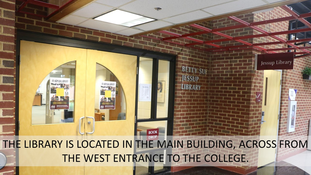 THE LIBRARY IS LOCATED IN THE MAIN BUILDING, ACROSS FROM THE WEST ENTRANCE TO THE COLLEGE.