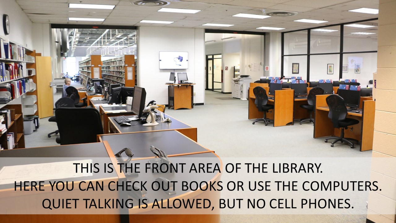 THIS IS THE FRONT AREA OF THE LIBRARY.   HERE YOU CAN CHECK OUT BOOKS OR USE THE COMPUTERS. QUIET TALKING IS ALLOWED, BUT NO CELL PHONES.