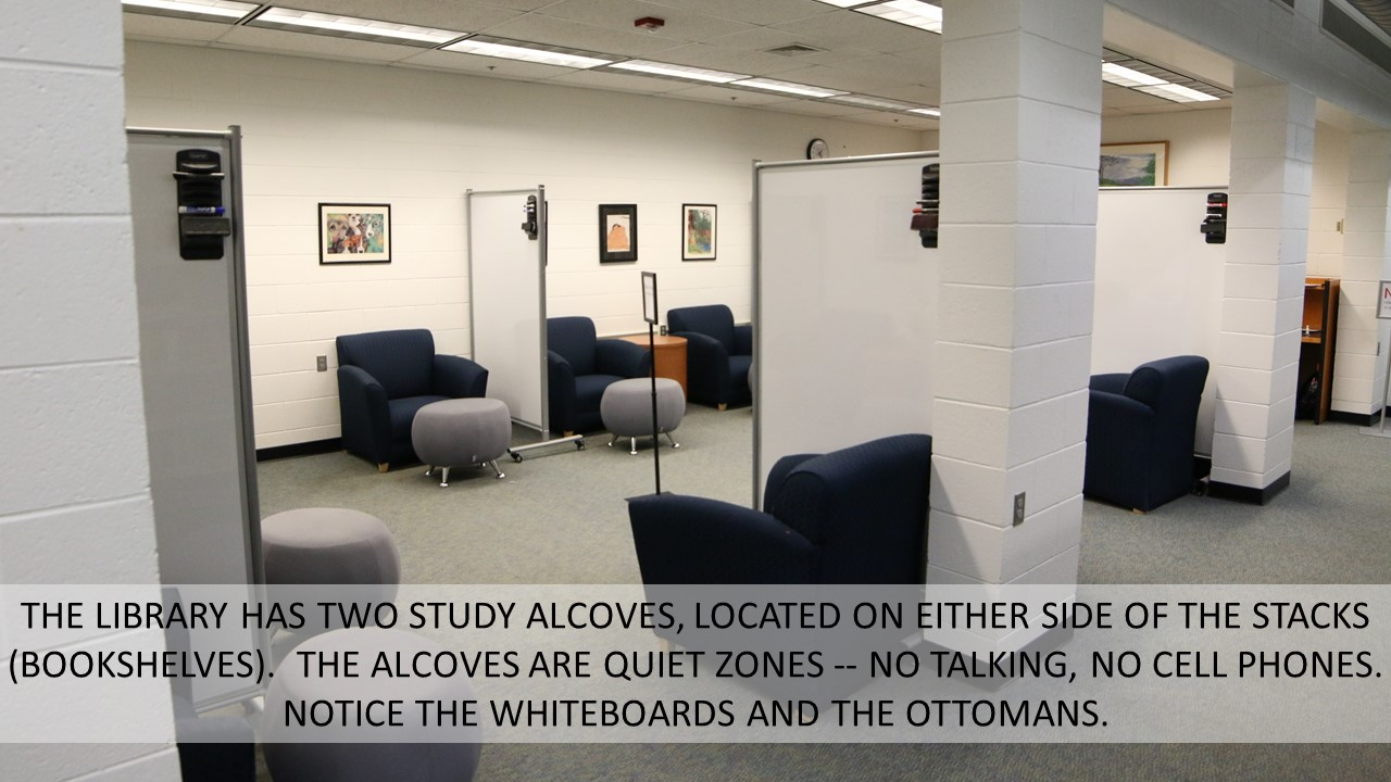 THE LIBRARY HAS TWO STUDY ALCOVES, LOCATED ON EITHER SIDE OF THE STACKS (BOOKSHELVES).  THE ALCOVES ARE QUIET ZONES -- NO TALKING, NO CELL PHONES.  NOTICE THE WHITEBOARDS AND THE OTTOMANS.