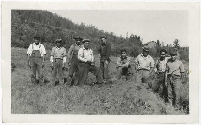 Indian Civilian Conservation Corps crew on stockade site at end of first day's work, Grand Portage