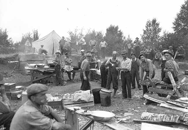Works Progress Administration workers from Duluth assigned to fight fire having lunch at camp, Pequaywan Lake region