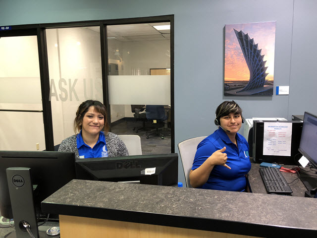 Picture of staff at the Ask Us Desk