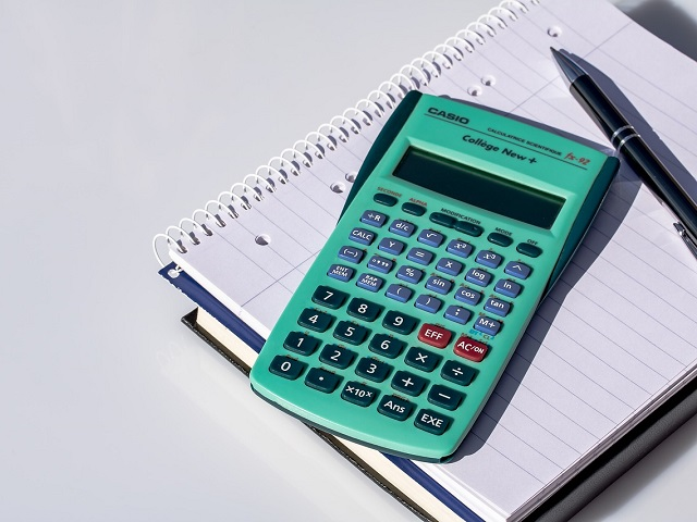 Image of a calculator with a notebook