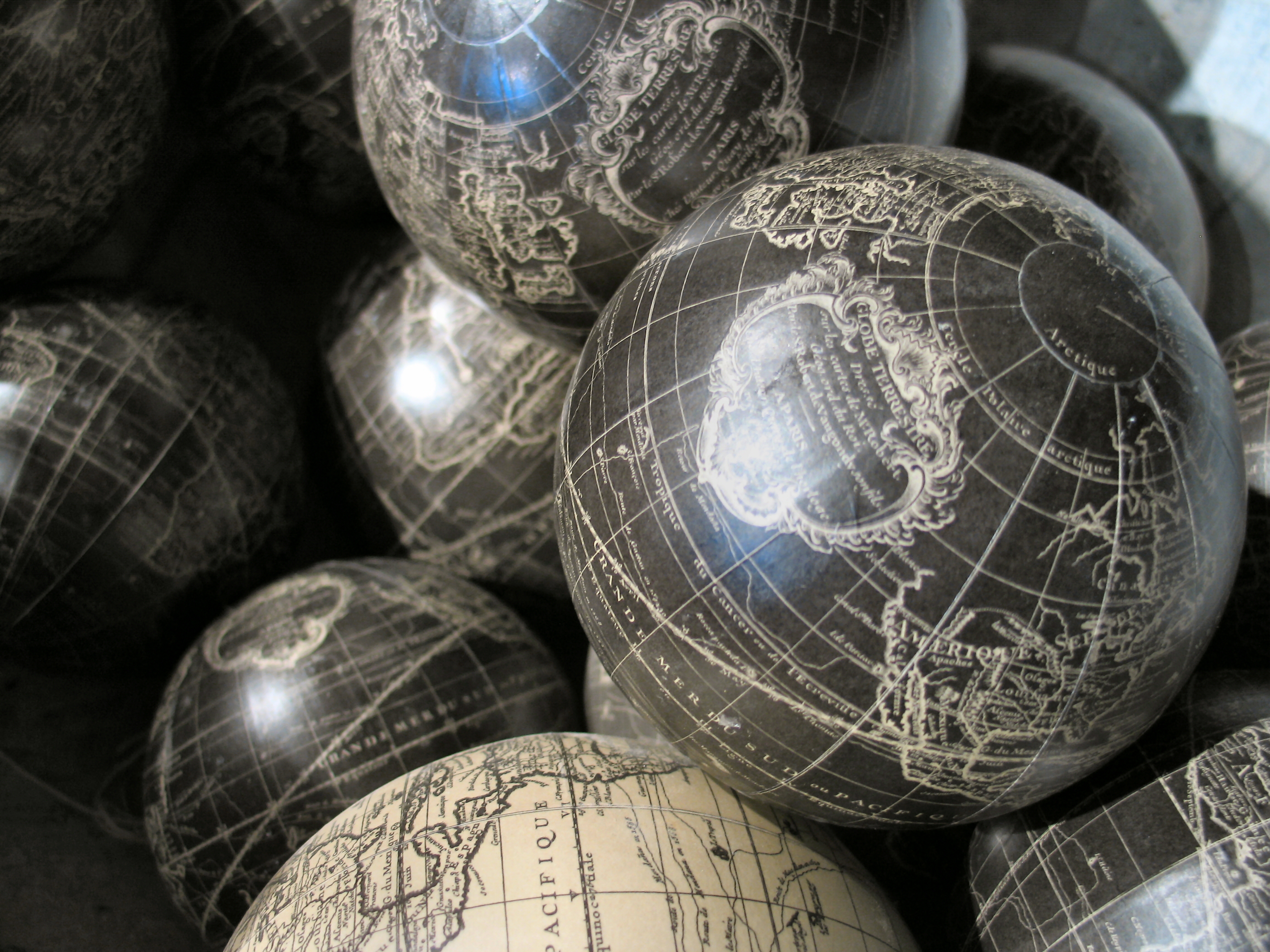 photo of a pile of antique globes