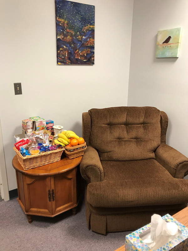 Image of food pantry manager's office stocked with grab and go snacks