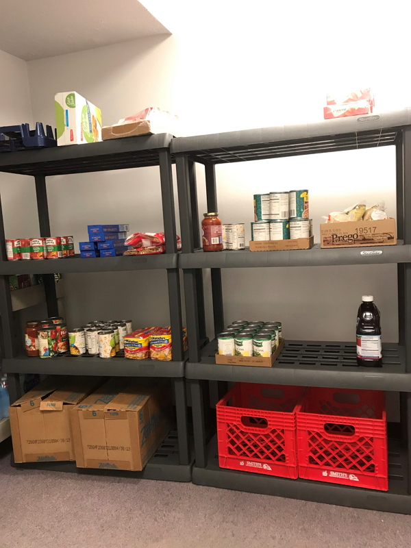 Image of food pantry shelves stocked with food