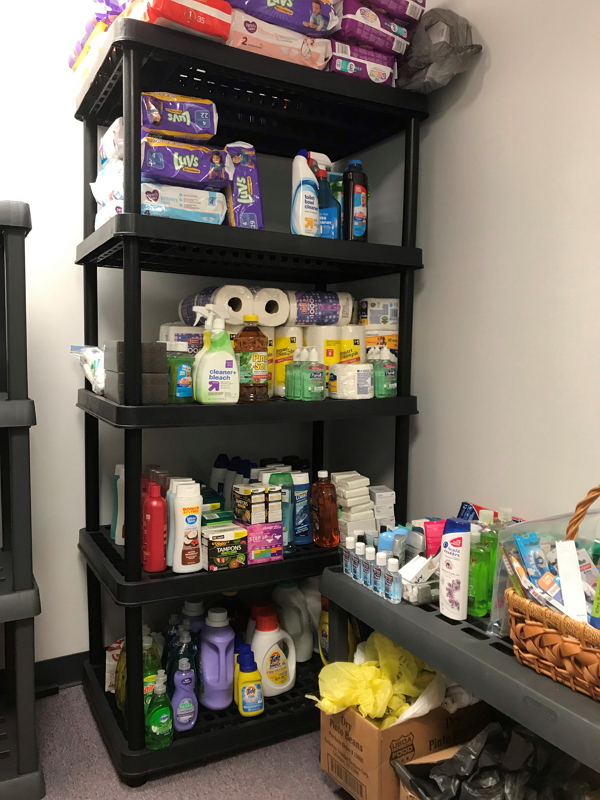 Image of food pantry shelves stocked with toiletry items