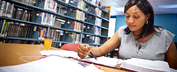 student working on a research paper