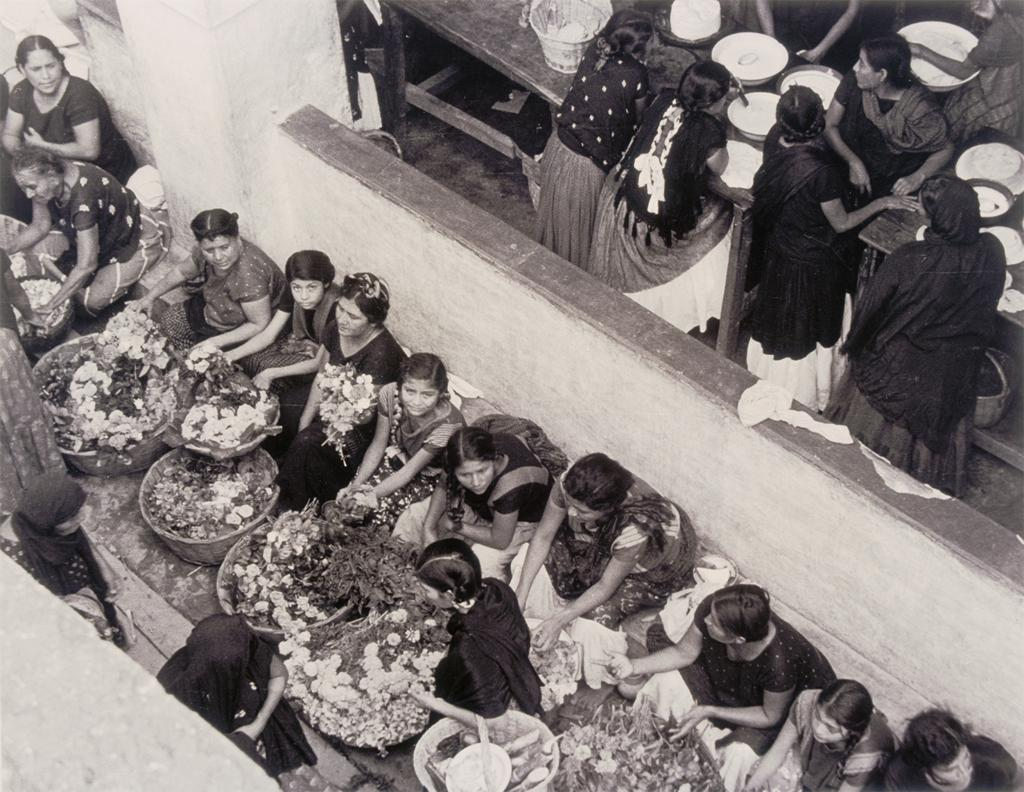 Photograph showing an overhead view of flower vendors and their merchandise.