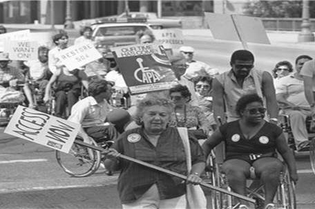 Photo of people in wheelchairs protesting for accessible public transit.