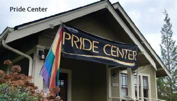 Image of house with Pride Center flag and banner