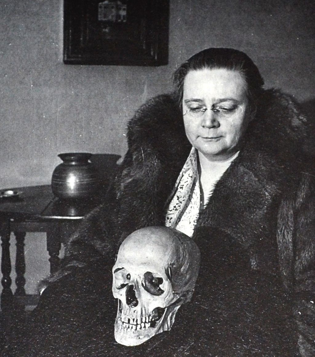 Picture of Dorothy L. Sayers holding a skull