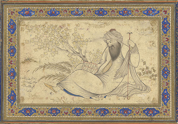 Reclining man in Arab dress reading a book outdoors