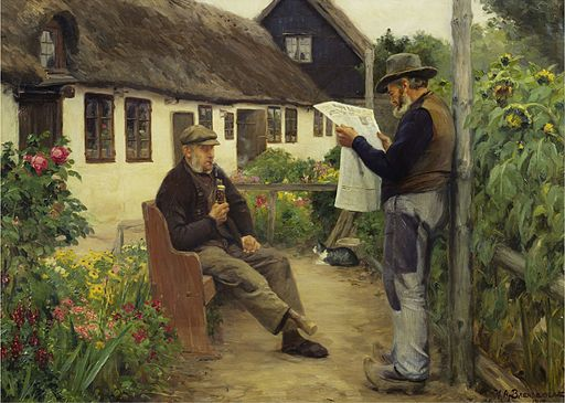 Two countrymen, one reading newspaper in garden by thatched cottage