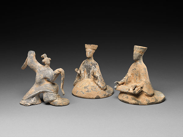 Ceramic dancer and two musicians