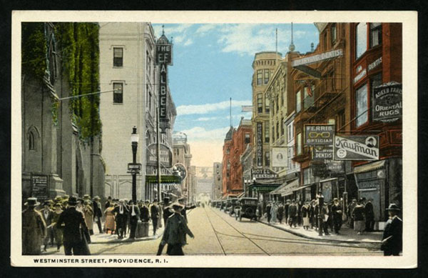 Postcard of downtown Providence with store fronts and signs