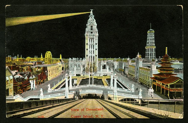 Postcard of amusement park at night lit by electric lights