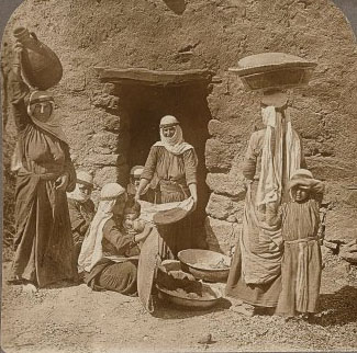 19th century photograph of Palestinian women in traditional dress