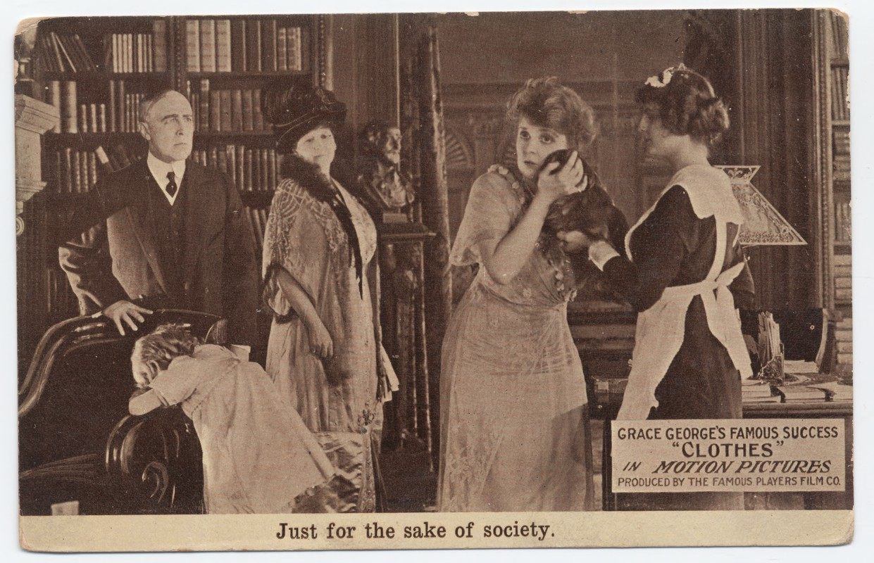 Actors in clothes of the 1910s on a domestic interior set.