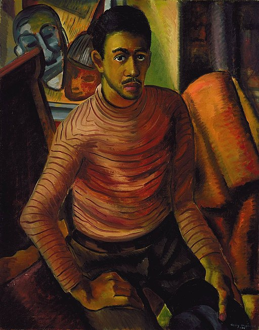 Self-portrait of African American artist with painting behind him.